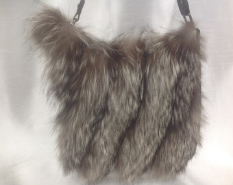 Black backpack with recycled silver fox fur