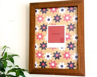 Carved wooden floral frame with your personal polaroid print included