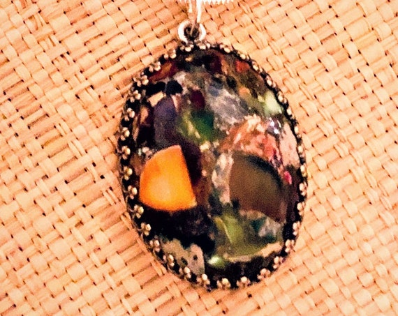 Sea Sediment Jasper Cabochon encased in a Silver Plated Setting.