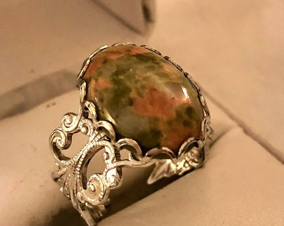 Unakite adjustable ring encased in a White Plated Filigree Setting