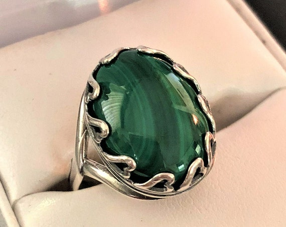 This adjustable Malachite Ring is surrounded by Hearts in a Silver Plated setting.