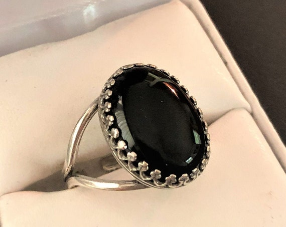 Black Onyx adjustable ring in a Silver-plated Crown setting.