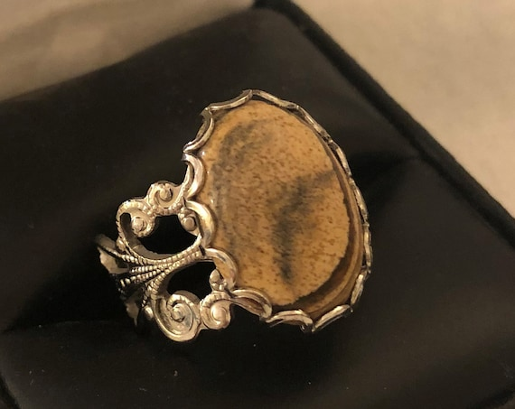 Picture Jasper adjustable ring encased in a White Plated Filigree Setting.