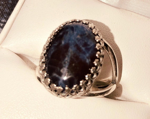 This Sodalite adjustable ring is set in a silver-plated crown bezel setting.