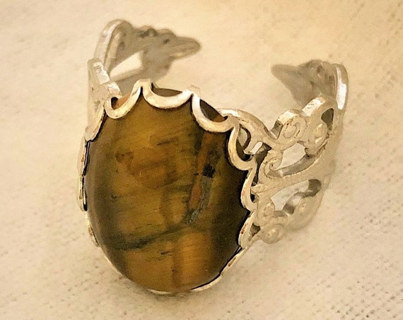 Tiger Eye Jasper adjustable ring encased in a White Plated Filigree Setting.