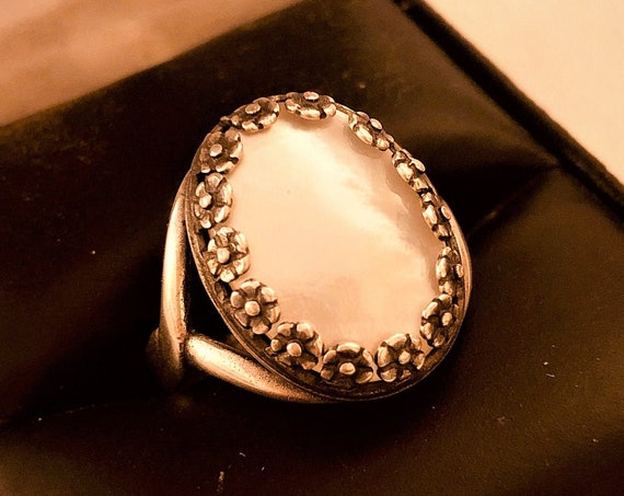 Mother of Pearl Adjustable Ring in a Silver Plated Floral Setting.