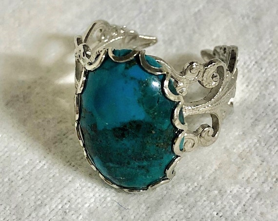 Turquoise adjustable Ring encased in a White Plated Filigree Setting