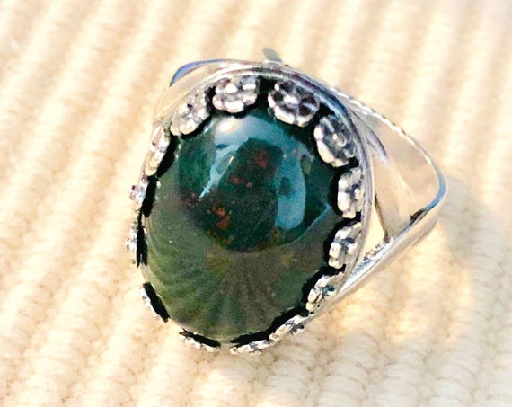 This is a Bloodstone Cabochon encased in a Silver Plated Adjustable Setting.