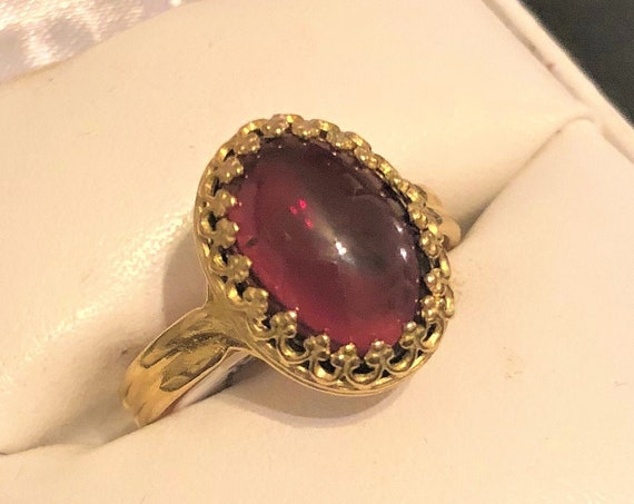 Garnet adjustable Ring surrounded with a Brass Crown Setting.