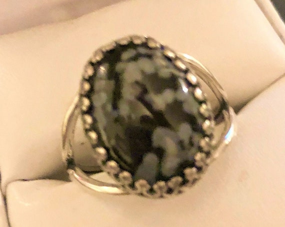Snowflake Obsidian  adjustable Ring encased in a Silver Plated Crown Setting.