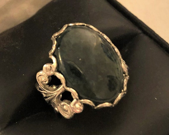 Moss Agate Adjustable Ring in a White Plated .Filigree Setting