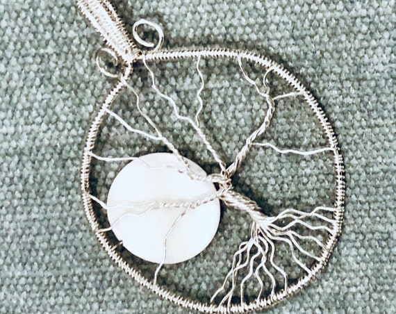"""This """"Rising Moon"""" Tree of Life"""" was created by wire wrapping Sterling Silver Wire with a Shell Bead."""