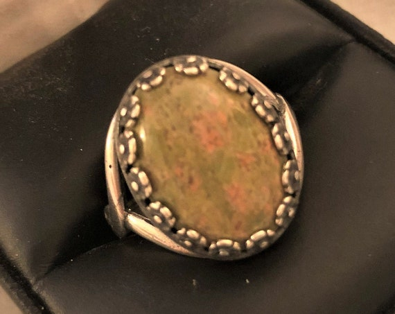 Unakite adjustable ring encased in a Silver Plated Floral Setting.