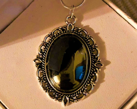 This Hematite gemstone is fashioned into a lovely silver-plated setting and comes with a 18 inch Sterling Silver Chain.