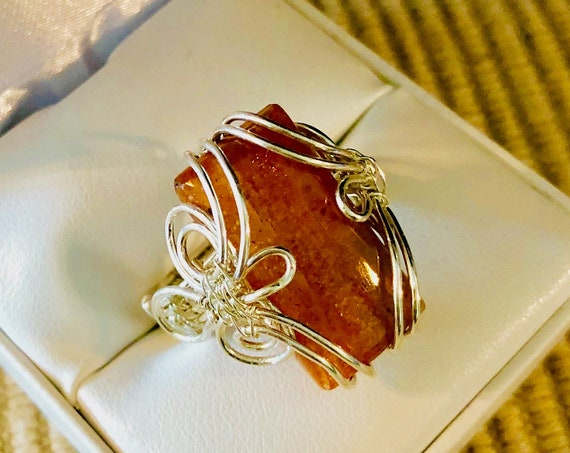 Sunstone Crystal Ring wire woven with Sterling Silver Wire.