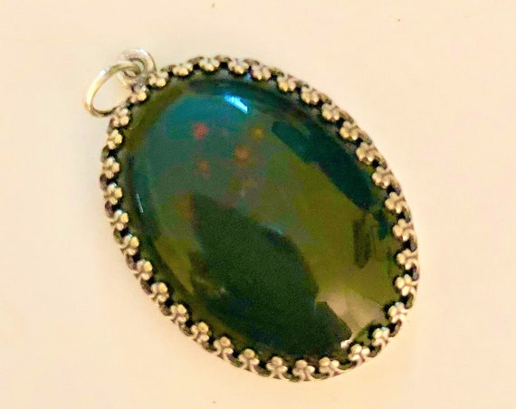 Bloodstone Cabochon encased in s Silver Plated Setting.