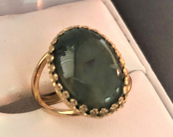 This adjustable Moss Agate Ring has a brass crown setting.