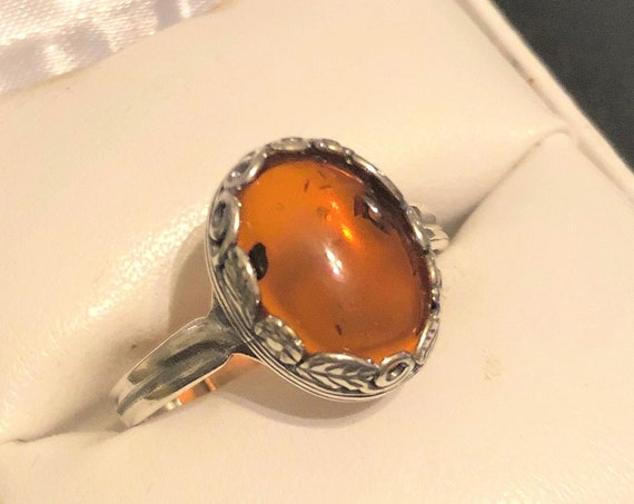 Amber adjustable Ring encased in a Silver Plated Flower and Leaves Setting
