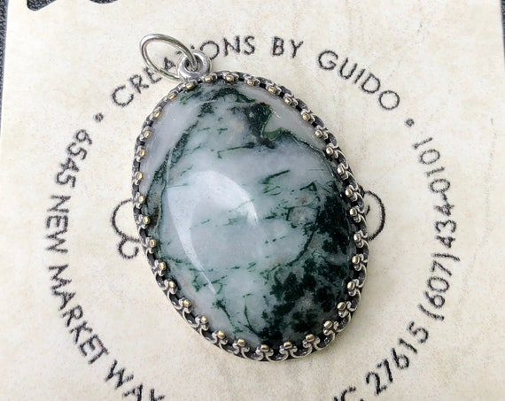 Tree Agate Cabochon surrounded by a Silver Plated Setting