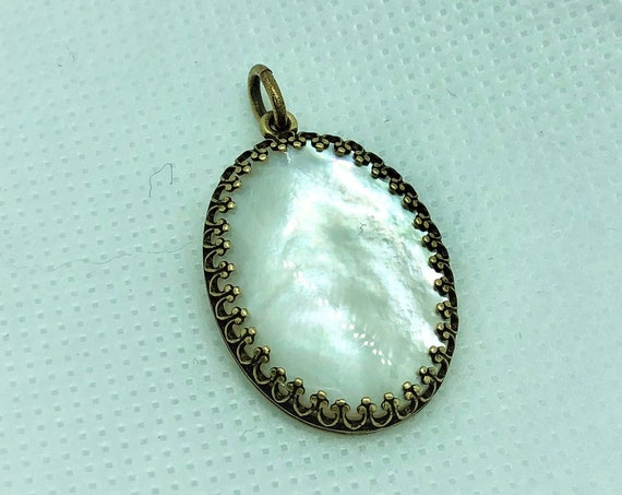 This Mother of Pearl Pendant is set in Brass and includes an Oxidized Copper adjustable chain.
