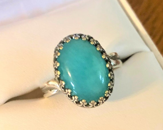 Amazonite adjustable ring encased in a silver-plated crown bezel.