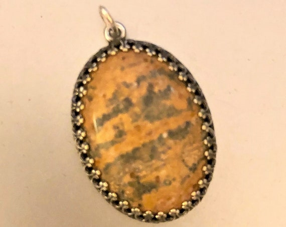 Leopard Skin Jasper Cabochon encased in a Silver Plated Setting.