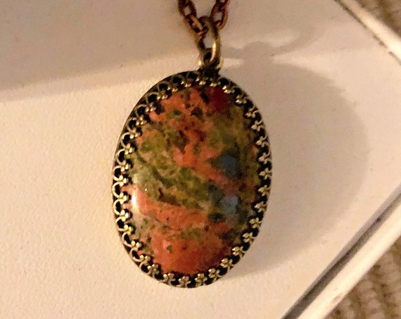 Unakite Cabochon Pendant encased in a Brass Setting
