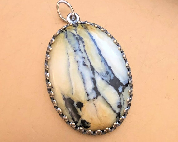 Russian Turquoise Cabochon encased in a Silver Plated Setting.