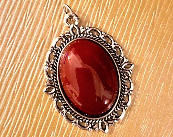 Carnelian Cabochon Pendant encased in a Silver Plated Setting