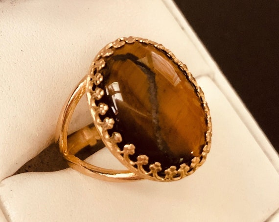 Stunning Tiger Eye adjustable Ring surrounded with a Brass Crown Setting.