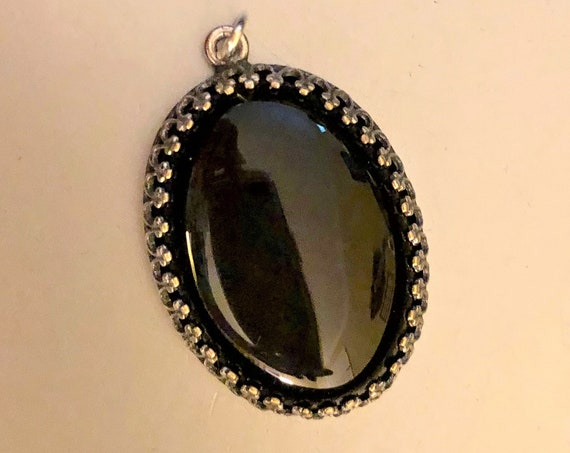 Black Onyx Cabochon encased in a Silver Plated Setting.