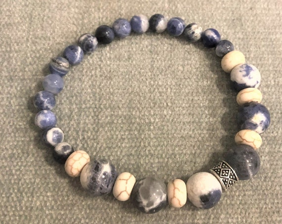 Sodalite beaded stretch bracelet is coordinated with Howlite beads and silver plated spacers.