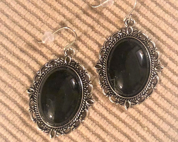 Black Onyx Earrings in a Silver Plated Setting.