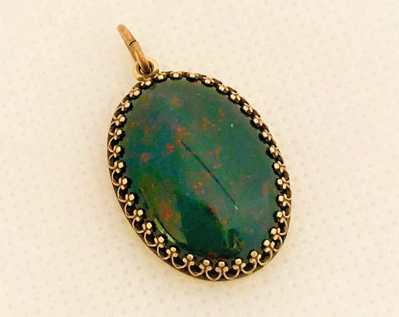 "This Bloodstone Cabochon is set in a brass crown and includes a 24"" adjustable oxidized copper chain."