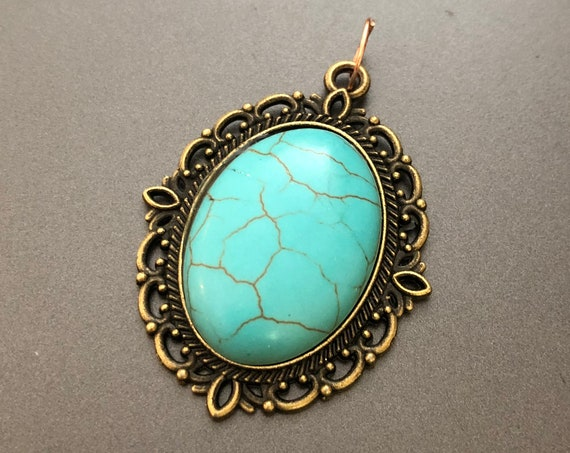 Natural Turquoise Cabochon surrounded by a Brass Setting