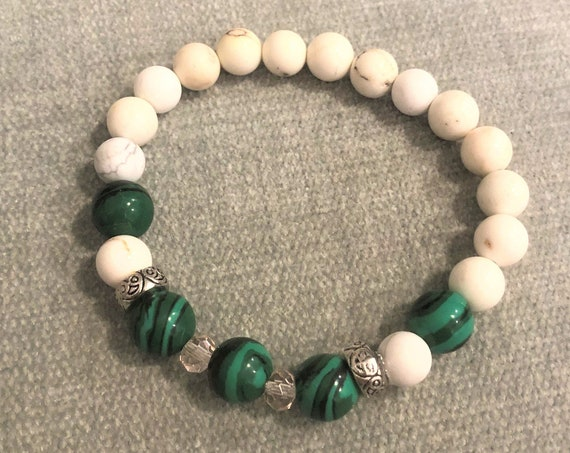 Man made Malachite stretch bracelet with Howlite, silver plated spacer beads and crystal beads.