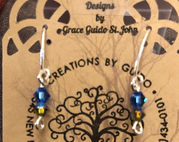 Blue Swarovski Crystals Earrings wrapped with Sterling Silver Wire.
