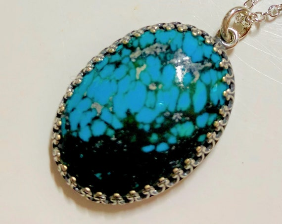 Chinese Turquoise Cabochon Pendant set in a Silver Plated Setting.