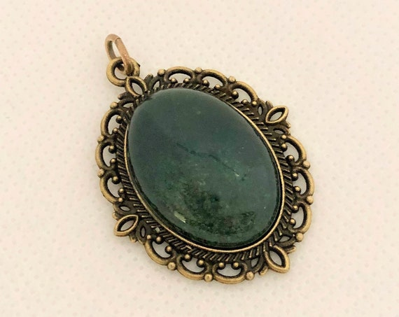 This Moss Agate Cabochon is set in a brass setting and includes an adjustable oxidized copper chain.