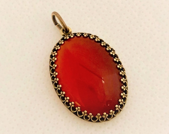 This Carnelian Cabochon is set in a brass setting and includes an oxidized copper adjustable chain.