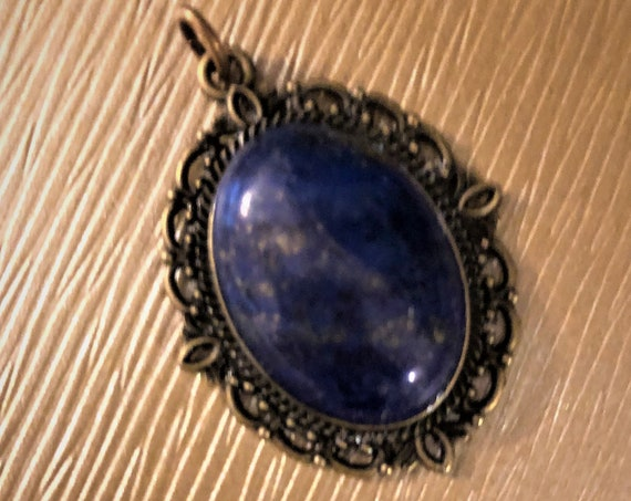 Lapis Lazuli Cabochon Pendant encased in a Brass Setting.