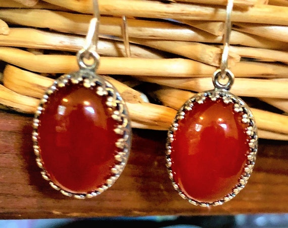 Carnelian Earrings are set in a silver-plated crown bezel and have sterling silver ear wires.
