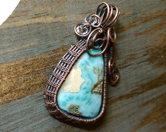 Larimar Teardrop Pendant Necklace using a Feather Wire Weave.   Larimar properties are Love, Personal Power and Healing