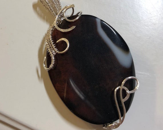 Striped Red Agate is woven with Sterling Silver Wire.
