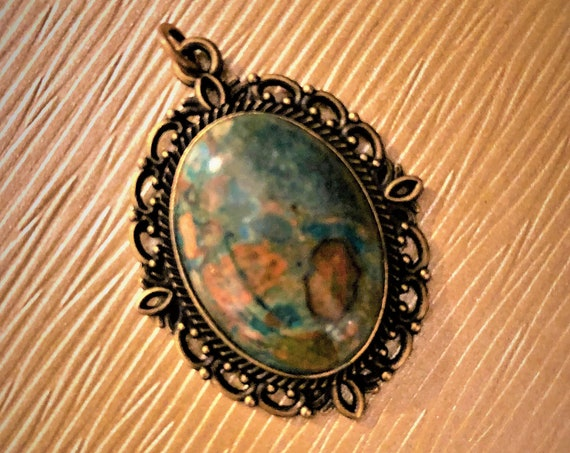 Ghost Eye Jasper Cabochon Pendant surrounded by a Silver Plated Setting.
