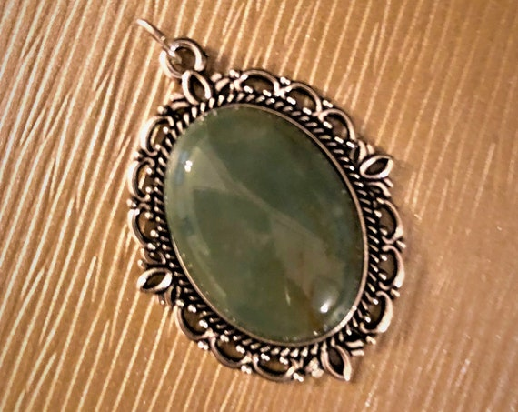Fancy Jasper Cabochon Pendant encased in a Silver Plated Setting.