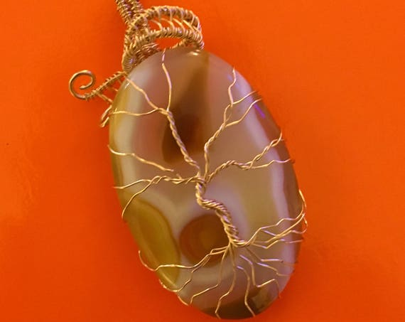 Coconut Jasper Tree of Life w/ 14K Gold Filled Wire.   Coconut Jasper properties are Support, Protection, Determination