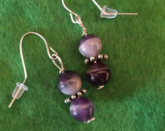 Dog Tooth Amethyst Bead Earrings wrapped with Sterling Silver Wire.