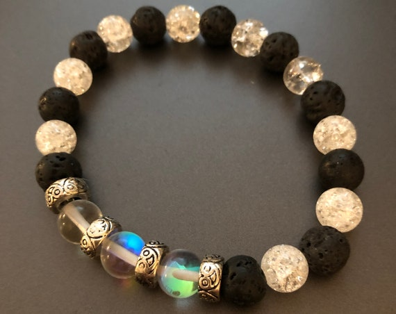 Aroma Therapy Bracelet made with Clear Iridescent Beads, Crackled Quartz Beads and Lava Rock Beads.