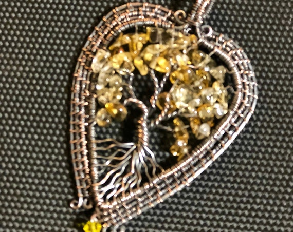This Citrine Tree of Life Pendant emanates positivity and joy.